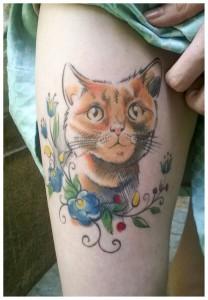 cat with polish folk flowers tattoo