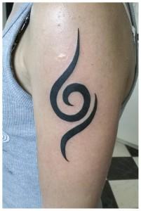curl tattoo